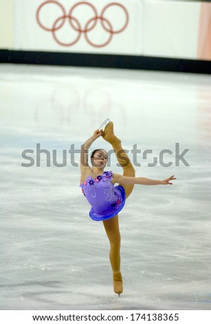 TURIN, ITALY - FEBRUARY 24, 2006: An athelete performs during the Winter Olympics female's final of the Figure Ice Skating. - stock photo