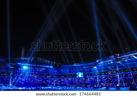 TURIN, ITALY-FEBRUARY 11, 2006: Blue lights shows during the pening ceremony at the Winter Olympic Games of Turin 2006.