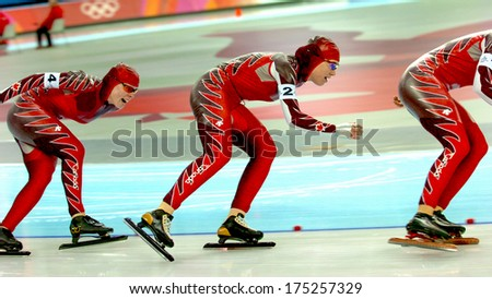 TURIN, ITALY-FEBRUARY 17, 2006: Canadian team competing during the Speed Ice Skating competition of the Winter Olympic Games of Turin 2006.