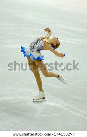 TURIN, ITALY - FEBRUARY 22, 2006: Carolina Kostner (Italy) performs during the Winter Olympics female's competition of the Figure Ice Skating.