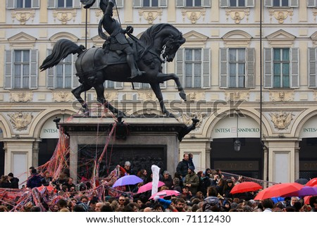 TURIN, ITALY- FEBRUARY 13: demonstration against Berlusconi, politics corruption, for women rights, on February, 13, 2011. During the event there has been a flash mob with umbrellas and balls of wool