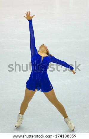 TURIN, ITALY - FEBRUARY 22, 2006: Emilie Hughes (USA) performs during the Winter Olympics female's competition of the Figure Ice Skating. - stock photo
