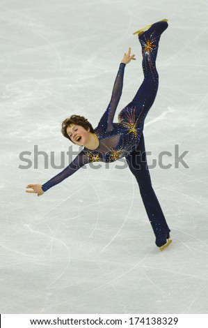 TURIN, ITALY - FEBRUARY 22, 2006: Irina Slutskaya (Russia) performs during the Winter Olympics female's competition of the Figure Ice Skating. - stock photo