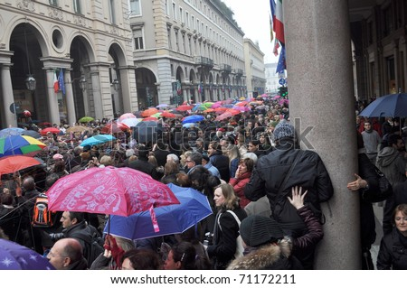 "TURIN, ITALY - FEBRUARY 13: Italian women rally called ""Se non ora quando"" (""If not now, when"") against Silvio Berlusconi February 13, 2011 in Turin, Italy"