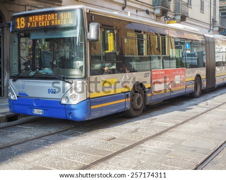 TURIN, ITALY - FEBRUARY 19, 2015: pedestrians and buses in Turin city centre