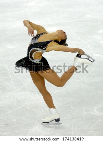 TURIN, ITALY - FEBRUARY 22, 2006: Silvia Fontana (Italy) performs during the Winter Olympics female's competition of the Figure Ice Skating. - stock photo