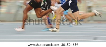 TURIN, ITALY - JULY 25: Blurred image of running competitors of 100m speed round of the Turin 2015 Italian Athletics Championships at the Primo Nebiolo Stadium on July 25, 2015 in Turin, Italy - stock photo