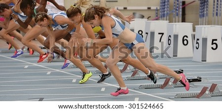 TURIN, ITALY - JULY 25: Competitors of 100m speed Women Round of the Turin 2015 Italian Athletics Championships at the Primo Nebiolo Stadium on July 25, 2015 in Turin, Italy - stock photo