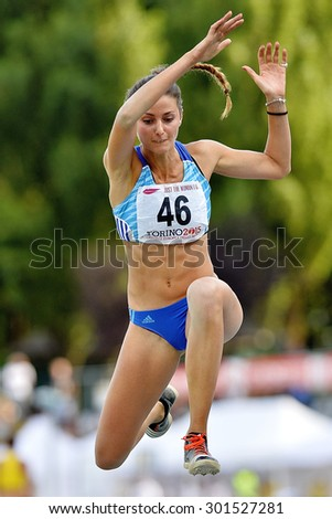 TURIN, ITALY - JULY 26: Eleonora D'Elicio perform triple jump during Turin 2015 Italian Athletics Championships at the Primo Nebiolo Stadium on July 26, 2015 in Turin, Italy - stock photo