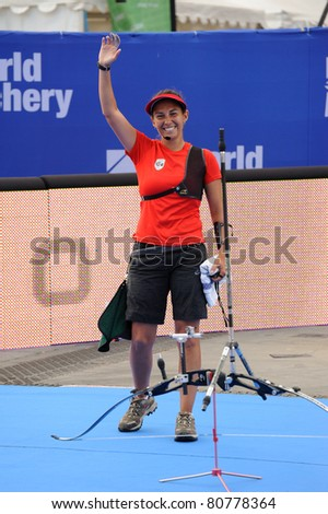 TURIN, ITALY-JULY 10: VAN LAMOEN Denisse (CHI), 2011 women recurve world champion, cheers after victory at 2011 World Archery and Para Archery Championships , on June 10, 2011 in Turin, Italy.