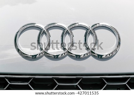 TURIN, ITALY - JUNE 13, 2015: Audi logo on a white car body on display at Turin open air car show