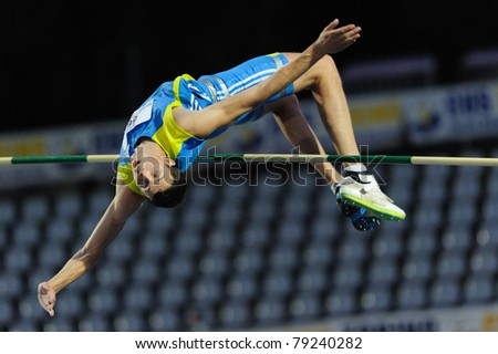 TURIN, ITALY - JUNE 10: Bondarenko Bodan (UKR) performs high jump during the 2011 Memorial Primo Nebiolo track and field athletics international meeting, on June 10, 2011 in Turin, Italy. - stock photo