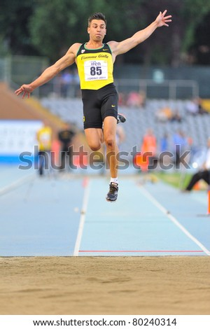 TURIN, ITALY - JUNE 25: CATANIA Emanuele performs a long jump during the 2011 Summer Track and Field Italian Championship meeting on June 25, 2011 in Turin, Italy. - stock photo
