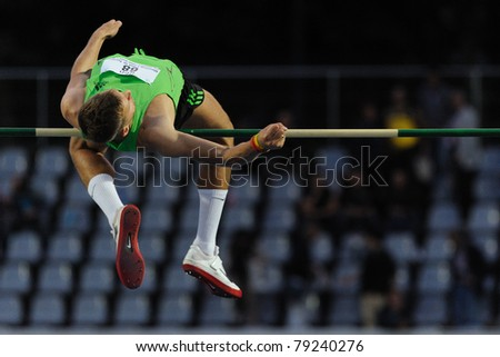 TURIN, ITALY - JUNE 10: Dmitrik Alexsey (RUS) performs high jump during the 2011 Memorial Primo Nebiolo track and field athletics international meeting, on June 10, 2011 in Turin, Italy. - stock photo