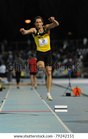 TURIN, ITALY - JUNE 10: Donato Fabrizio (ITA) performs triple jump during the 2011 Memorial Primo Nebiolo track and field athletics international meeting, on June 10, 2011 in Turin, Italy. - stock photo