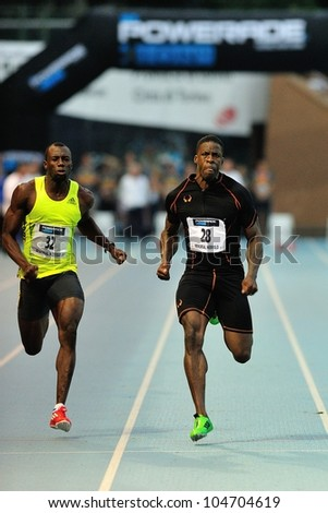 TURIN, ITALY - JUNE 08: Dwight Chambers (26) Su Sanneh (32) run 100m during the International Track & Field meeting Memorial Nebiolo 2012 on June 08, 2012 in Turin, Italy. - stock photo