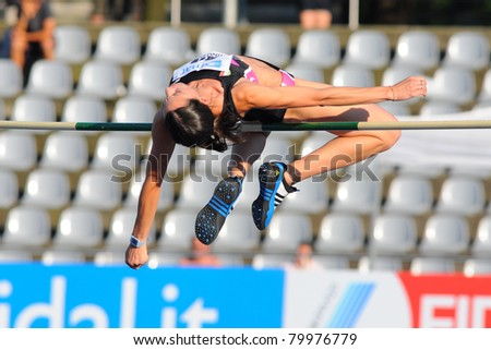 TURIN, ITALY - JUNE 25: Elena Meuti performs a high jump during the 2011 Summer Track and Field Italian Championship meeting on June 25, 2011 in Turin, Italy.