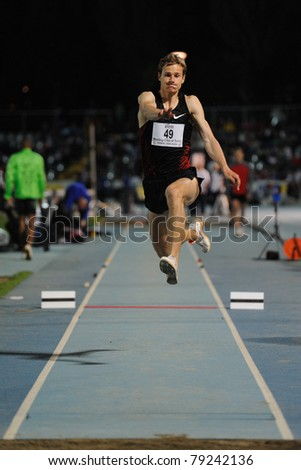 TURIN, ITALY - JUNE 10: Fedorov Aleksey (RUS) performs triple jump during the 2011 Memorial Primo Nebiolo track and field athletics international meeting, on June 10, 2011 in Turin, Italy. - stock photo
