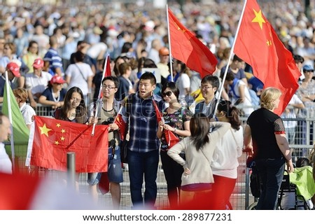 TURIN, ITALY - JUNE 21, 2015: Holy Father Pope Francesco Bergoglio visit Turin for the holy Shroud exhibition and the city cheers him with a joyful crowd in Vittorio Place. Pilgrims from China cheer. - stock photo
