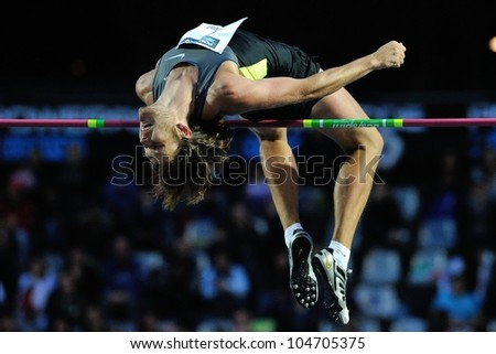 TURIN, ITALY - JUNE 08: Ivan Ukhow performs high jump during the International Track & Field meeting Memorial Nebiolo 2012 on June 08, 2012 in Turin, Italy. - stock photo