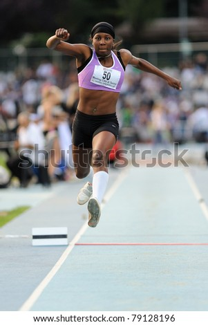 TURIN, ITALY - JUNE 10: Kessely Haoua (FRA) performs triple jump during the 2011 Memorial Primo Nebiolo track and field athletics international meeting, on June 10, 2011 in Turin, Italy. - stock photo