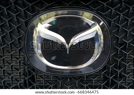 TURIN, ITALY - JUNE 10, 2017: Mazda logo on a car grill