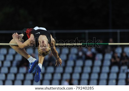 TURIN, ITALY - JUNE 10: Mudrov Sergey (RUS) performs high jump during the 2011 Memorial Primo Nebiolo track and field athletics international meeting, on June 10, 2011 in Turin, Italy. - stock photo