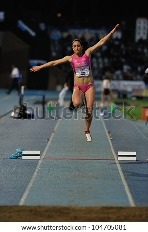 TURIN, ITALY - JUNE 08: Patricia Sarrapio ESP performs triple jump during the International Track & Field meeting Memorial Nebiolo 2012 on June 08, 2012 in Turin, Italy. - stock photo