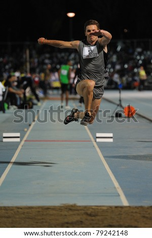 TURIN, ITALY - JUNE 10:Petrenko Aleksandr (RUS) performs triple jump during the 2011 Memorial Primo Nebiolo track and field athletics international meeting, on June 10, 2011 in Turin, Italy. - stock photo