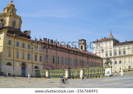 TURIN,ITALY - JUNE 26, 2015. Piazza Castello with Palazzo Reale and Church of San Lorenzo in the city of Turin ,beautiful attraction for  many tourists of the world.  - stock photo