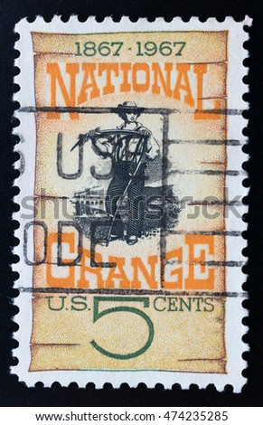TURIN, ITALY - JUNE 20, 2016: Postage stamp printed in USA celebrating the 100th anniversary of the National Grange, the american farmers organization, circa 1967