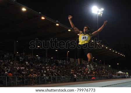 TURIN, ITALY - JUNE 25: Stefano Dacastello a performs a long jump during the 2011 Summer Track and Field Italian Championship meeting on June 25, 2011 in Turin, Italy. - stock photo