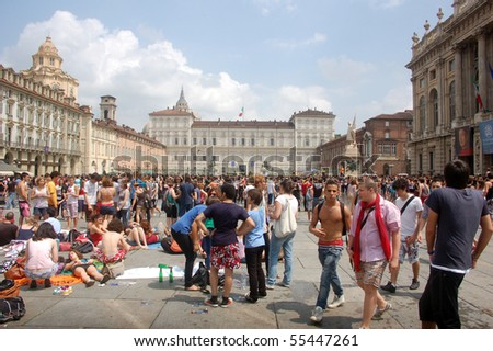 TURIN, ITALY - JUNE 12: Students celebrate the end of school year on Piazza Castello in Turin, Italy. - stock photo