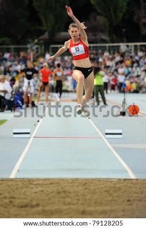 TURIN, ITALY - JUNE 10: Taranova Anastasia (RUS) performs triple jump during the 2011 Memorial Primo Nebiolo track and field athletics international meeting, on June 10, 2011 in Turin, Italy. - stock photo