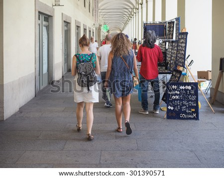 TURIN, ITALY - JUNE 19, 2015: Tourists in Via Po ancient central baroque street