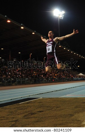 TURIN, ITALY - JUNE 25: TREMIGLIOZZI Stefano performs a long jump during the 2011 Summer Track and Field Italian Championship meeting on June 25, 2011 in Turin, Italy. - stock photo
