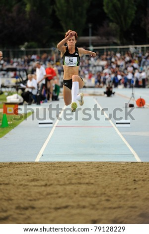 TURIN, ITALY - JUNE 10: Veldakova Dana (SVK) performs triple jump during the 2011 Memorial Primo Nebiolo track and field athletics international meeting, on June 10, 2011 in Turin, Italy. - stock photo