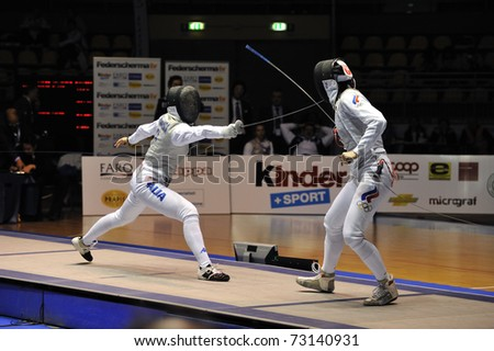 TURIN, ITALY - MARCH 13: Arianna ERRIGO (ITA) fight against Inna DERIGLAZOVA (RUS) during team tournament final match of the 2011 Women world fencing cup on March 13, 2011 in Turin, Italy - stock photo