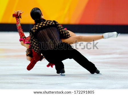 TURIN, ITALY - MARCH 28: Couple dancing during Figure Ice Skating competition of the  Winter Olympic Games in Turin, March, 28 2006.  - stock photo