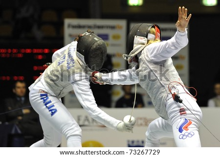 TURIN, ITALY - MARCH 13: Elisa DI FRANCISCA (ITA) fight against Inna DERIGLAZOVA (RUS) during team tournament final match of the 2011 Women world fencing cup on March 13, 2011 in Turin, Italy - stock photo