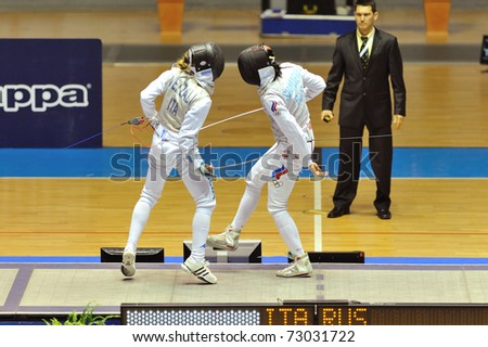 TURIN, ITALY - MARCH 12: fencer Valentina VEZZALI (ITA) fight against SHANEVA (RUS) during the 2011 Women world fencing cup on March 12, 2011 in Turin, Italy - stock photo