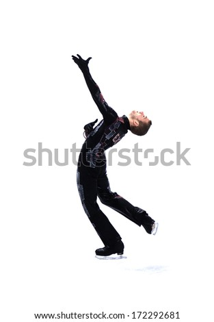 TURIN, ITALY - MARCH 29: ice skater dancing during Male Figure Ice Skating competition of the  Winter Olympic Games in Turin, March, 29 2006.  - stock photo