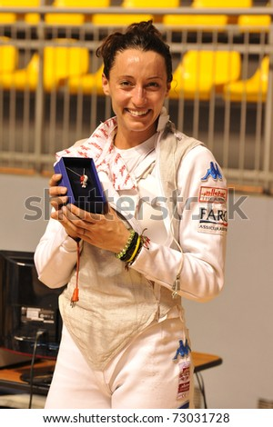 TURIN, ITALY - MARCH 12: Italian fencer Elisa DI FRANCISCA cheers during the 2011 Women world fencing cup on March 12, 2011 in Turin, Italy - stock photo
