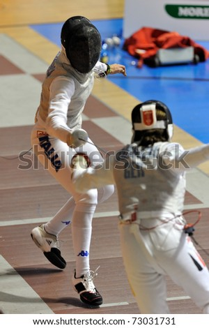 TURIN, ITALY - MARCH 12: Italian fencer Elisa DI FRANCISCA fight during the 2011 Women world fencing cup on March 12, 2011 in Turin, Italy - stock photo