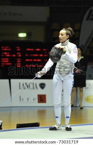 TURIN, ITALY - MARCH 12: Italian fencer Elisa DI FRANCISCA stands at semifinals match of the 2011 Women world fencing cup on March 12, 2011 in Turin, Italy - stock photo