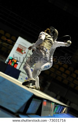 TURIN, ITALY - MARCH 12: Italian fencer Valentina VEZZALI fight against Arianna ERRIGO during final match of the 2011 Women world fencing cup on March 12, 2011 in Turin, Italy - stock photo