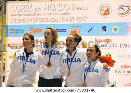 TURIN, ITALY - MARCH 12:  Italian fencers VEZZALI, DI FRANCISCA, ARRIGO and SALVATORI stand at podium the 2011 Women world fencing cup on March 12, 2011 in Turin, Italy - stock photo