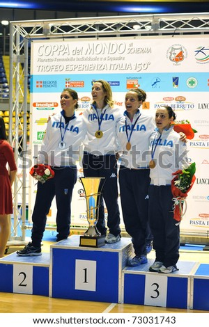 TURIN, ITALY - MARCH 12: Italian fencers VEZZALI, DI FRANCISCA, ARRIGO and SALVATORI stand at podium of the 2011 Women world fencing cup on March 12, 2011 in Turin, Italy - stock photo