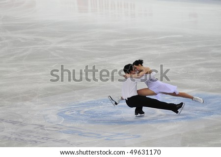 TURIN, ITALY - MARCH 26: Professional Canadian skaters Tessa VIRTUE & Scott MOIR perform free dance during the 2010 World Figure Skating Championship on March 26, 2010 in Turin, Italy. - stock photo