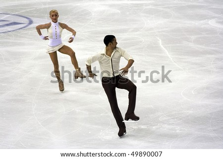 TURIN, ITALY - MARCH 24: Professional  German skaters Aliona SAVCHENKO and Robin SZOLKOWY perform pairs free skating during the 2010 World Figure Skating Championship on March 24, 2010 in Turin,Italy. - stock photo